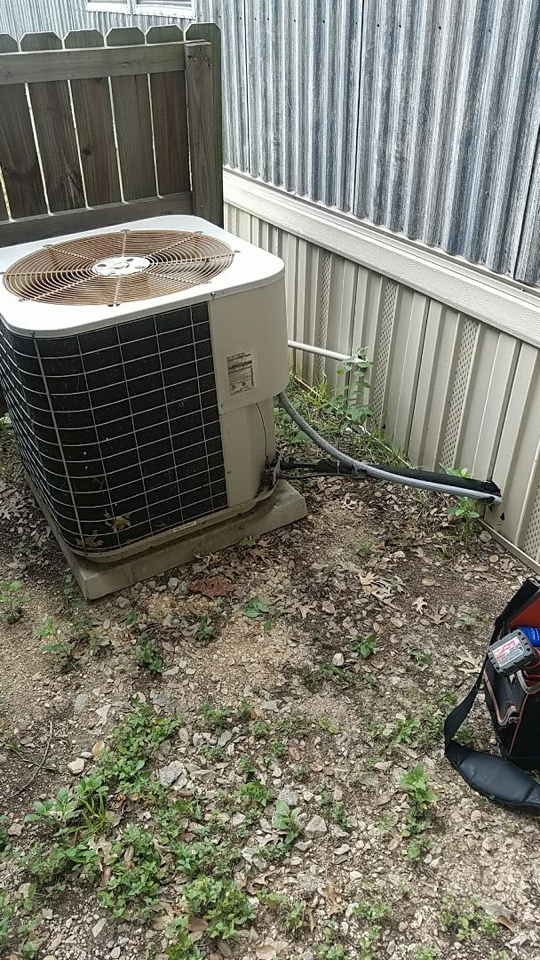 Manchaca, TX - AC repair on a mobile home AC unit with drain repair and full system check to prevent AC breakdown