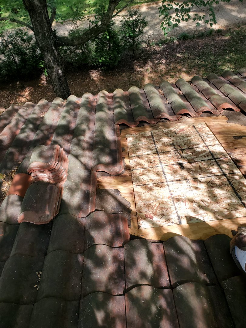 McLean, VA - AST Roofing was called to check on a leak.  The house has terracotta roof and AST Roofing replaced broken tiles and added ice and water barrier and replaced clay tiles.