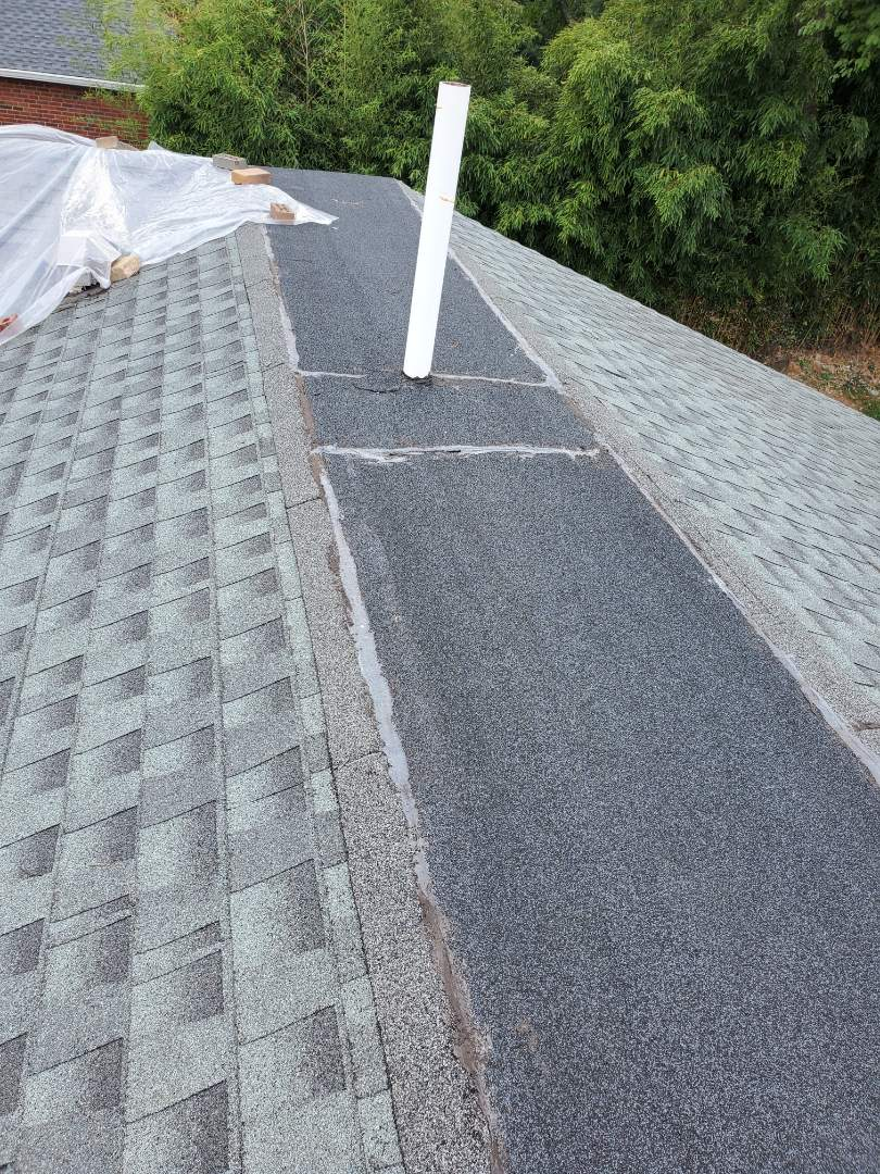 Alexandria, VA - AST Roofing was called in to identify source of several leaks in this private residence in Alexandria.  AST Roofing found prior roofer had incorrectly installed shingles and incorrectly installed the flat section of roof which covers area where a ridge would be.