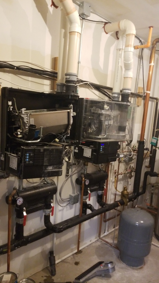 Grimes, IA - Replacing gaskets and performing maintenance on 2 Rinnai Q175SN boilers in residential Grimes.