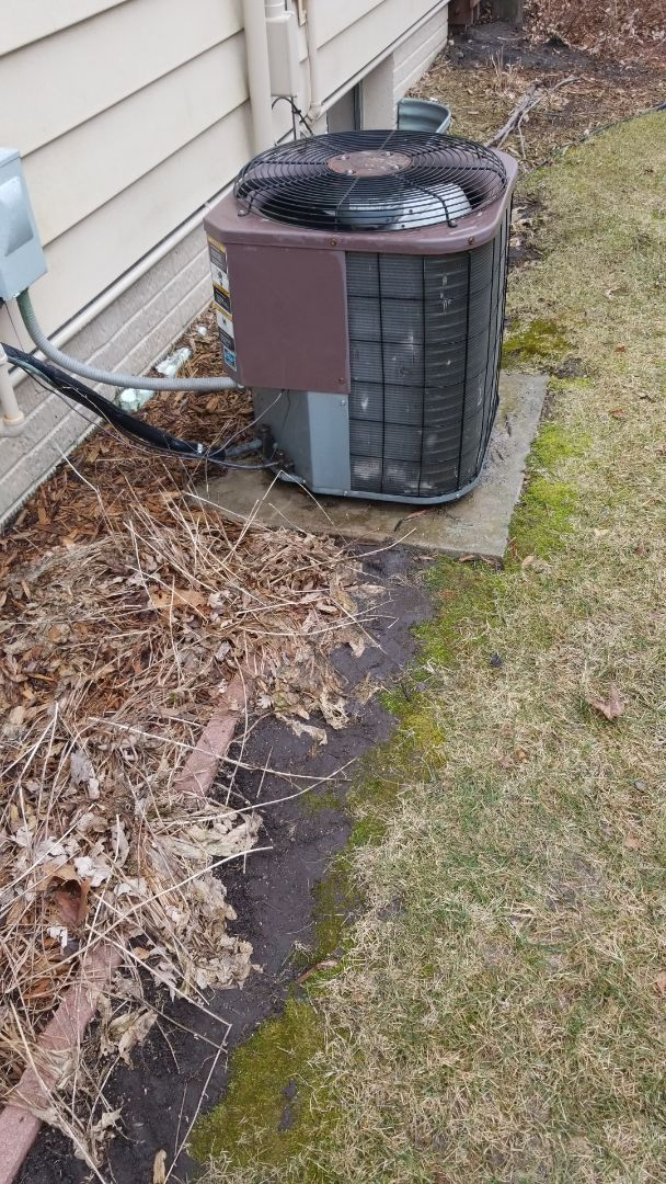 Servicing a 1993 Bryant A/C in residential Ames.