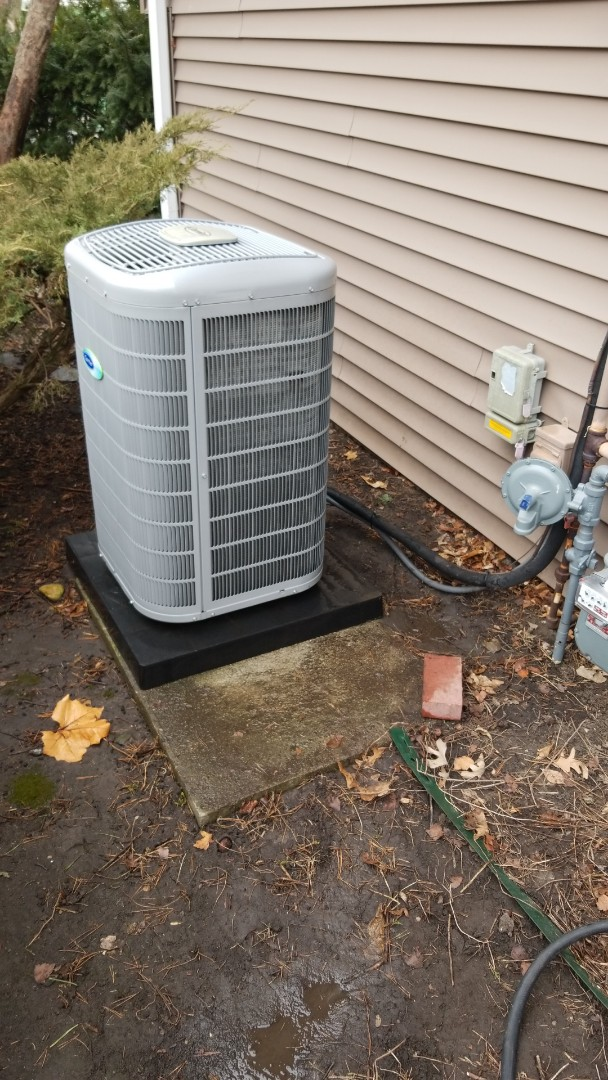 Servicing a 2014 Carrier A/C in residential Ames.