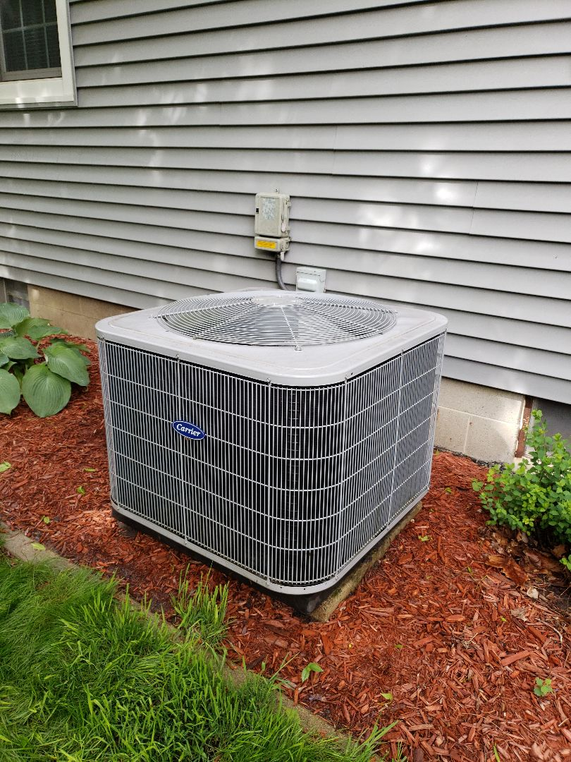 Servicing a 2013 carrier A/C in residential Ames