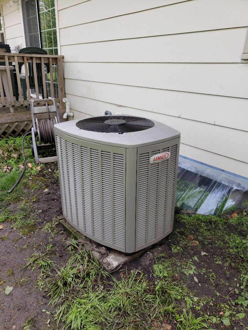 Servicing a 2009 Lennox A/C in residential Ames