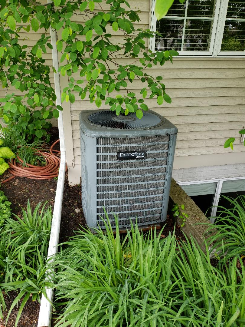 Servicing a 2007 Goodman A/C in residential Ames