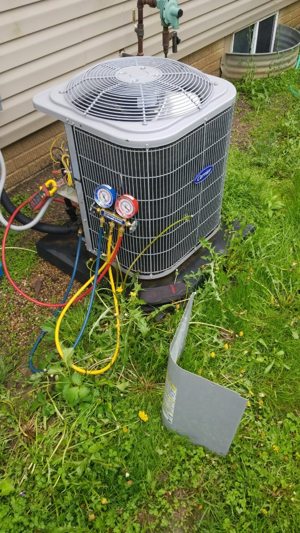 Maxwell, IA - Servicing a 2016 Carrier A/C in residential Ames.