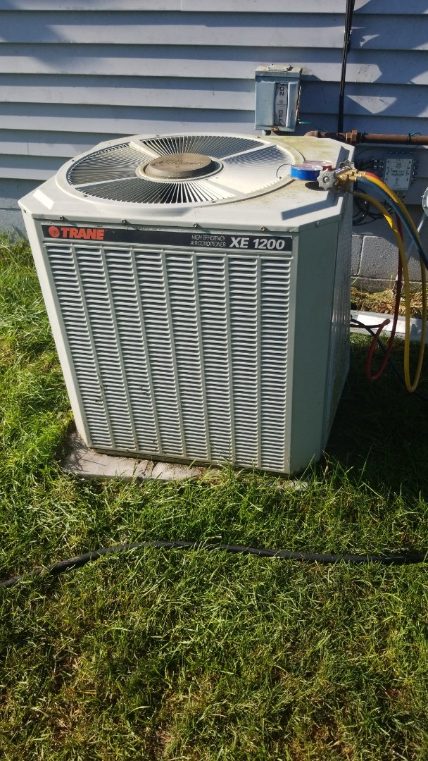 Maxwell, IA - Servicing a 1999 Trane A/C in residential Maxwell.