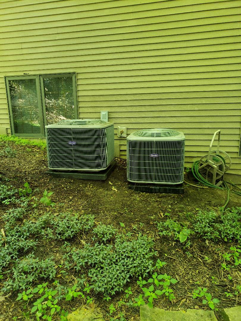Gilbert, IA - Servicing 2 Carrier A/C's in residential Ames