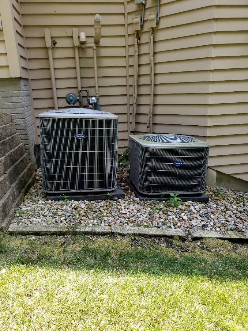 Gilbert, IA - Servicing 2 2012 Carrier A/C's in residential Ames