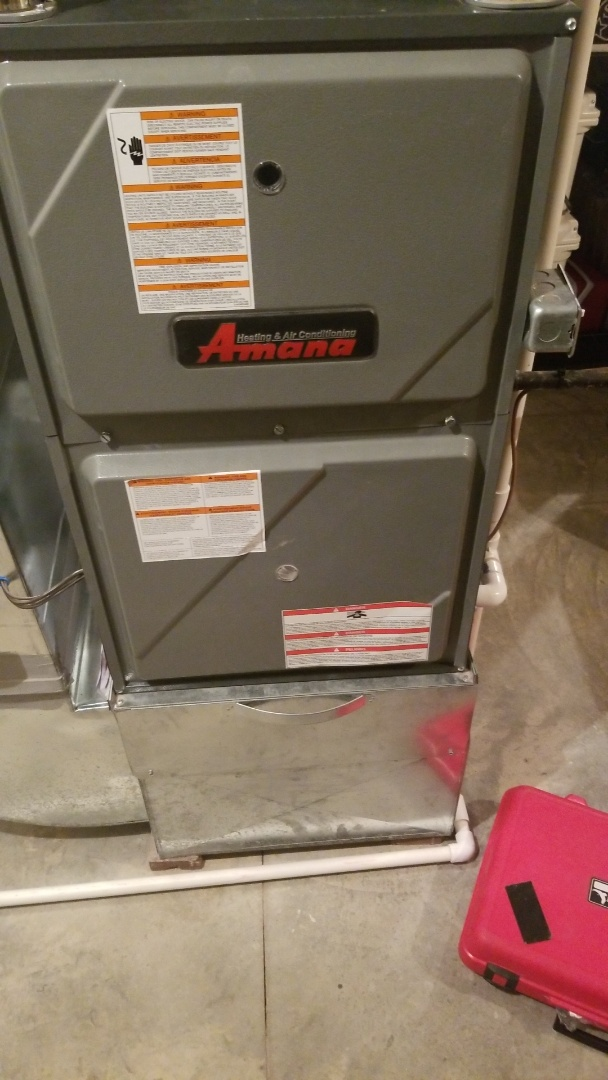 Grimes, IA - Performing planned maintenance on a 2015 Amana furnace in residential Grimes.