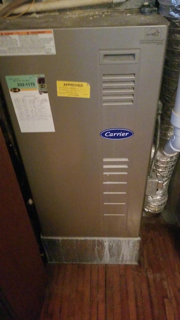 Gilbert, IA - Servicing a 2004 Carrier furnace in residential Gilbert.