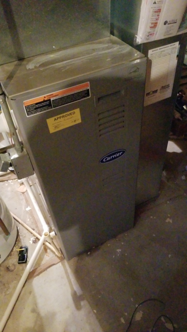 Servicing a 2002 Carrier furnace and a Lifebreath HRV in residential Ames.