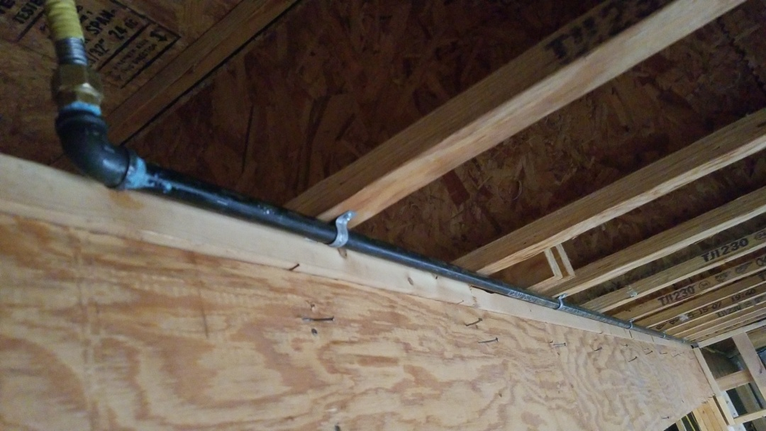 Replacing 15' of tracpipe with black iron prior to basement finishing in rural Ames.