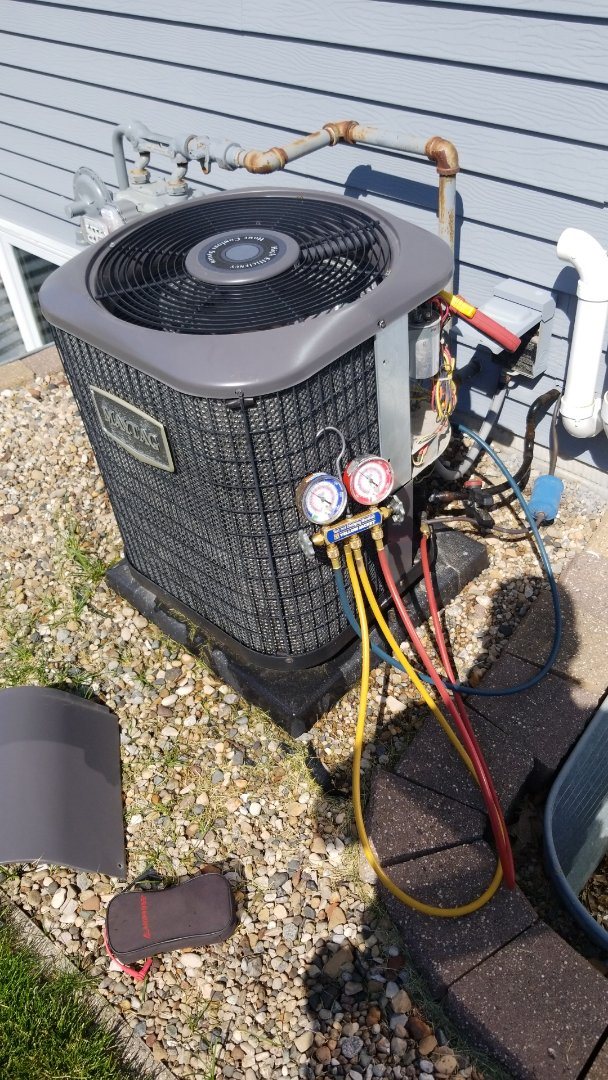 Gilbert, IA - Servicing a 2012 Maytag A/C in residential Gilbert.