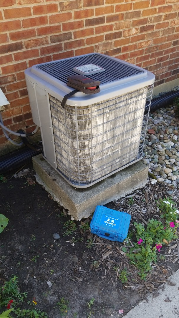 Ames, IA - Servicing a 2003 Heil A/C in residential Ames.