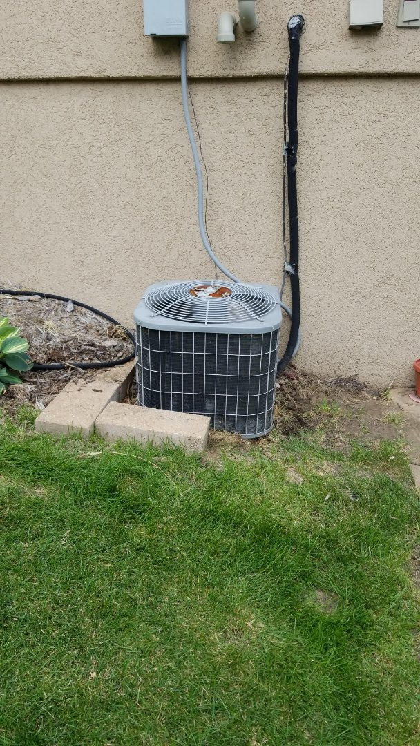 Ames, IA - Performed planned maintenance on a 2005 carrier unit in residential Ames.