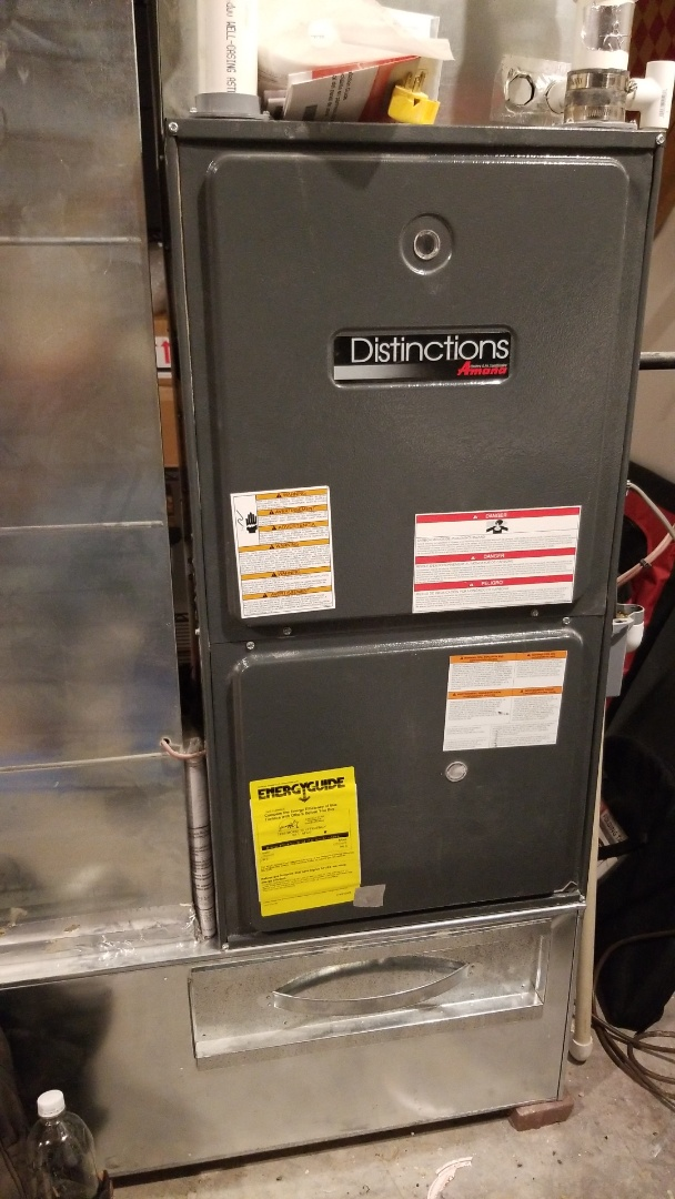 Cambridge, IA - Performing planned maintenance on a 2011 Amana furnace in rural Cambridge.