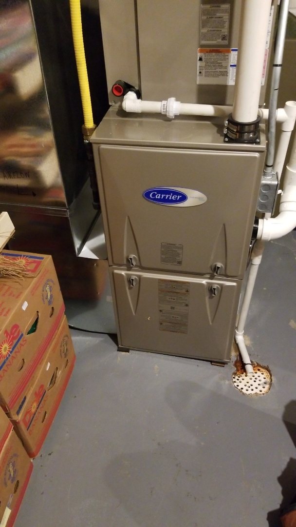 Ankeny, IA - Servicing a 2020 Carrier furnace in residential Ankeny.