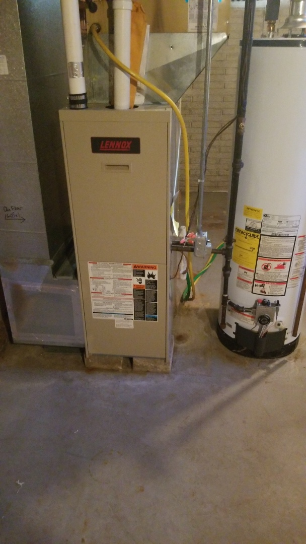 Colo, IA - Performing a safety inspection and filling out a fuel burning certificate on a 1995 Lennox and 2010 Kennore water heater in residential Ames.