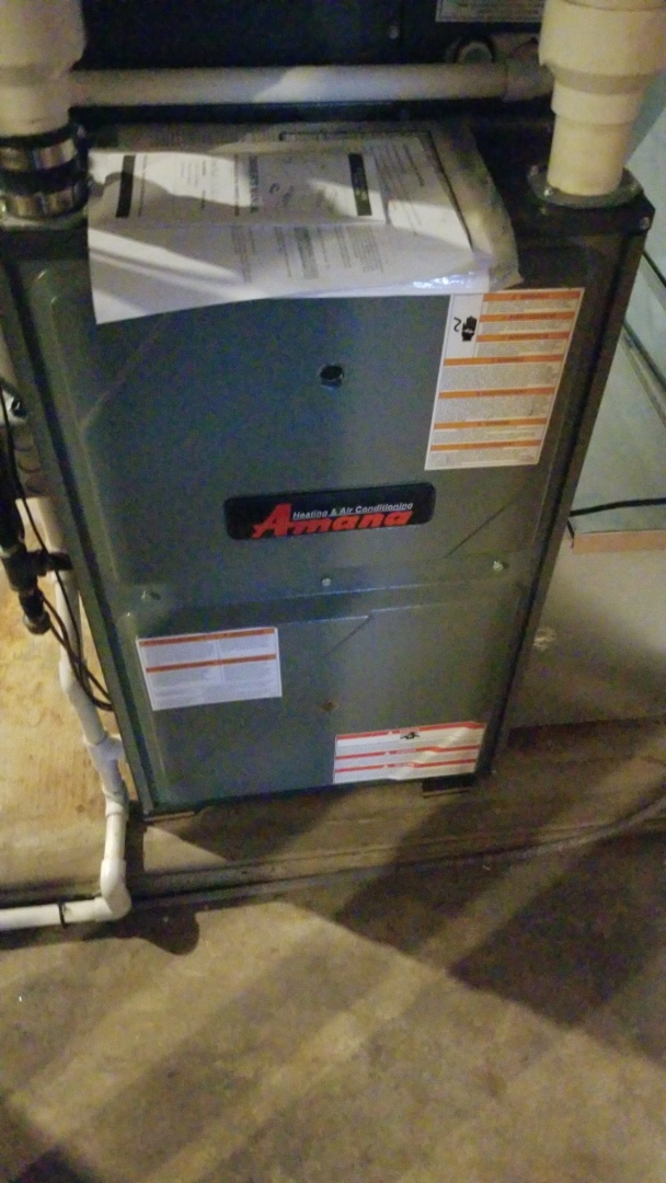 Roland, IA - Servicing a 2014 Amana heat pump with furnace back-up in residential Roland.