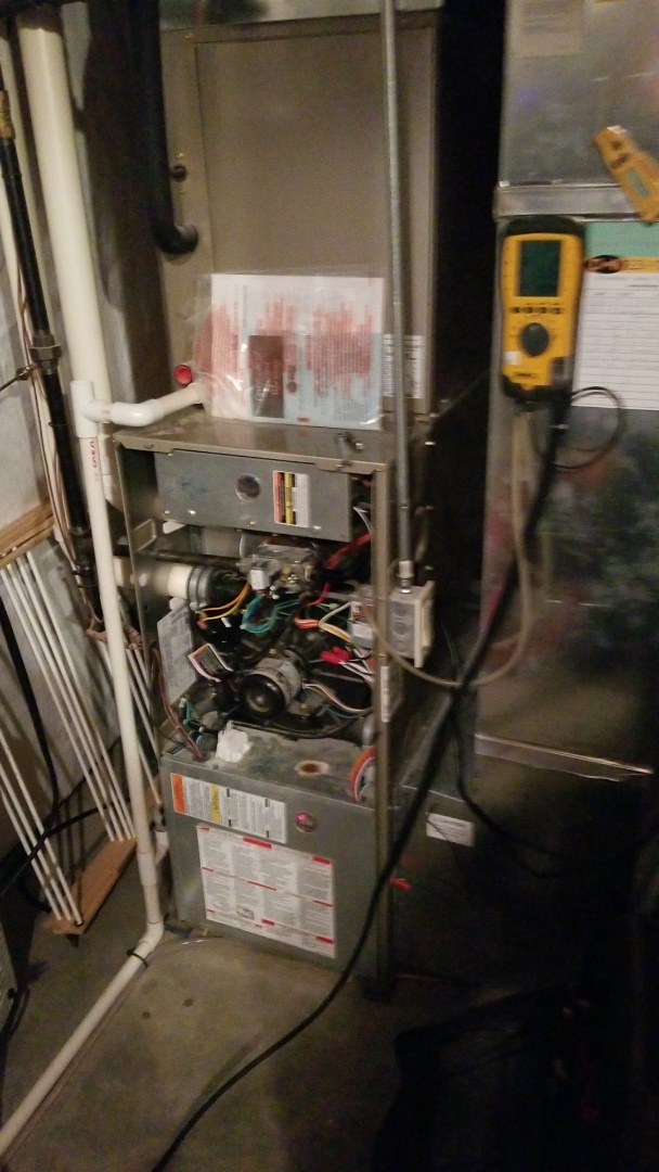 Polk City, IA - Performing a yearly furnace checkup on a Carrier furnace in Polk City Iowa