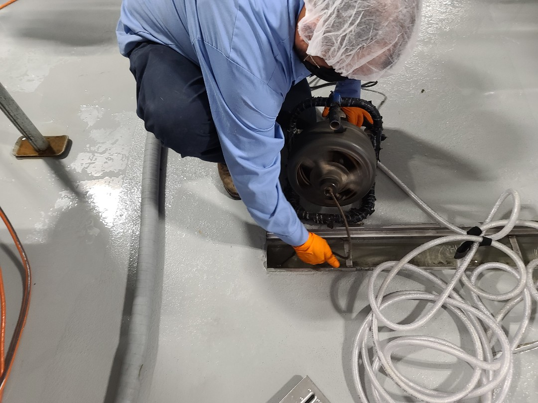Drain cleaning for packing facility.