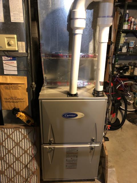 Dublin, OH - Pre season tune up/check out on a Carrier brand furnace. customer reported minor water leak from exhaust PVC.Identified leak was coming from where reducer and coupling meet. Taped around seal and restricted water flow.