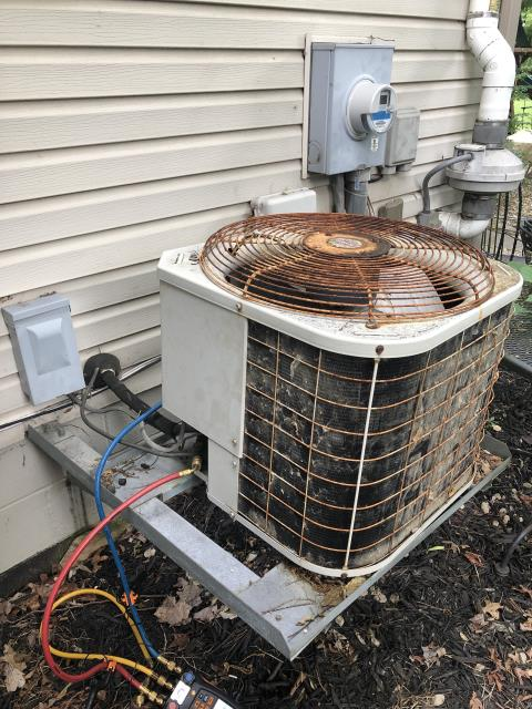 Delaware, OH - Bryant AC not cooling and has leak. Advice replacement due to age and condition of unit.