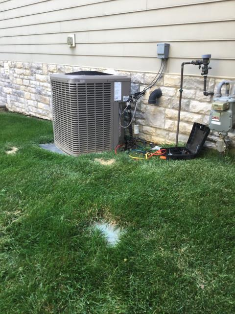New Albany, OH - System has been moved off its pad and is pressed up against the house can see area where the metal guard is bent indicating this has been hit. Customer uses lawn care service and I had customer come outside, he confirmed this is a newer finding, and that the system was nice and level on that pad not pressed up against the house. When we move a system dramatically like this it stresses the copper fittings and can cause a leak like we are finding.