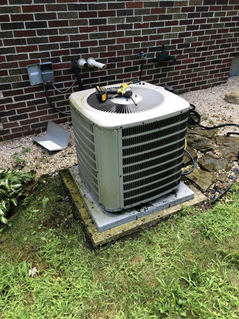 Pickerington, OH - Air Conditioning Tune up on 4 year old Goodman  unit. Upon arrival tech found the compressor not starting. Capacitor was good, removed fan to check compressor, hot to touch, cooled off with water from hose and started up. Coil was extremely dirty, restricting airflow.