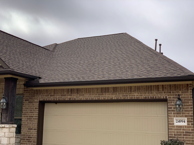 Porter, TX - Our team was able to get this beautiful new roof completed before the rain rolled in!