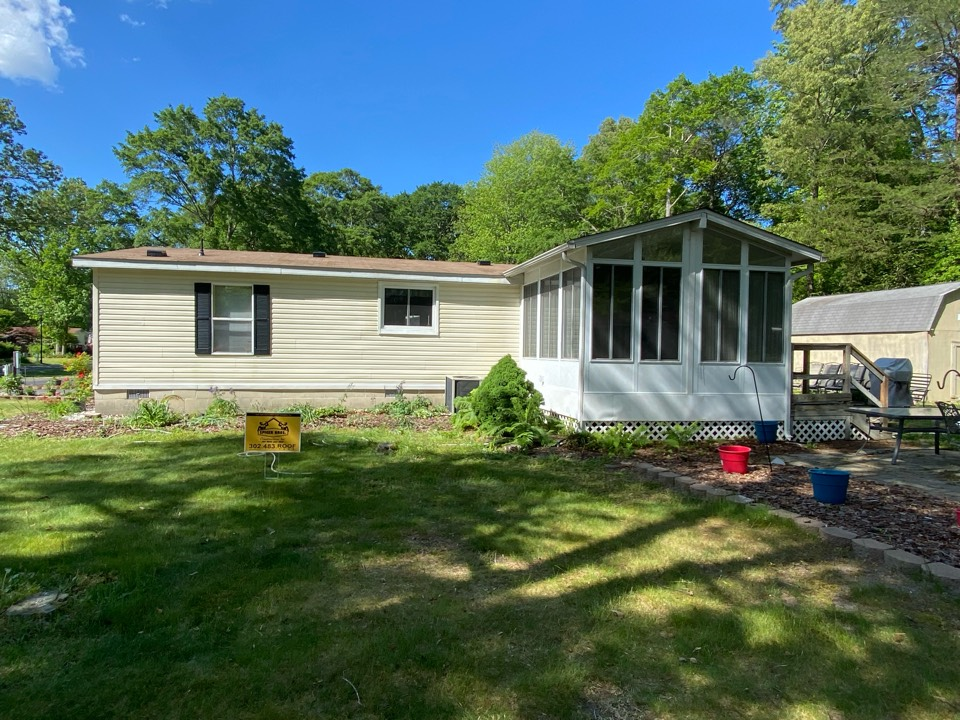 Georgetown, DE - We just finished replacing this with with brand new royal sovereign 3 tab shingles Golden cedar on color.
