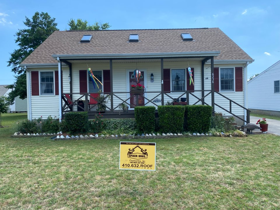 We just finished replacing this house with brand new timberline HD's shake wood in color shingles and installed a new ridge vent.