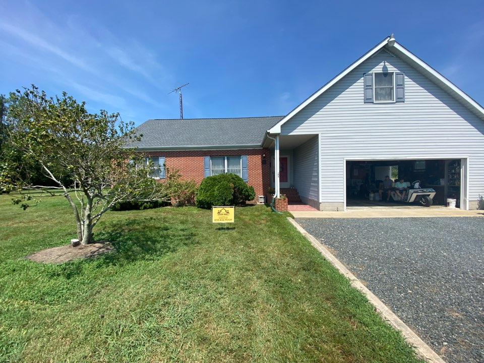 Cambridge, MD - We just finished replacing this house with brand new Timberline HDZ shingles pewter grey in color and installed brand new ridge vent using GAF snow country.