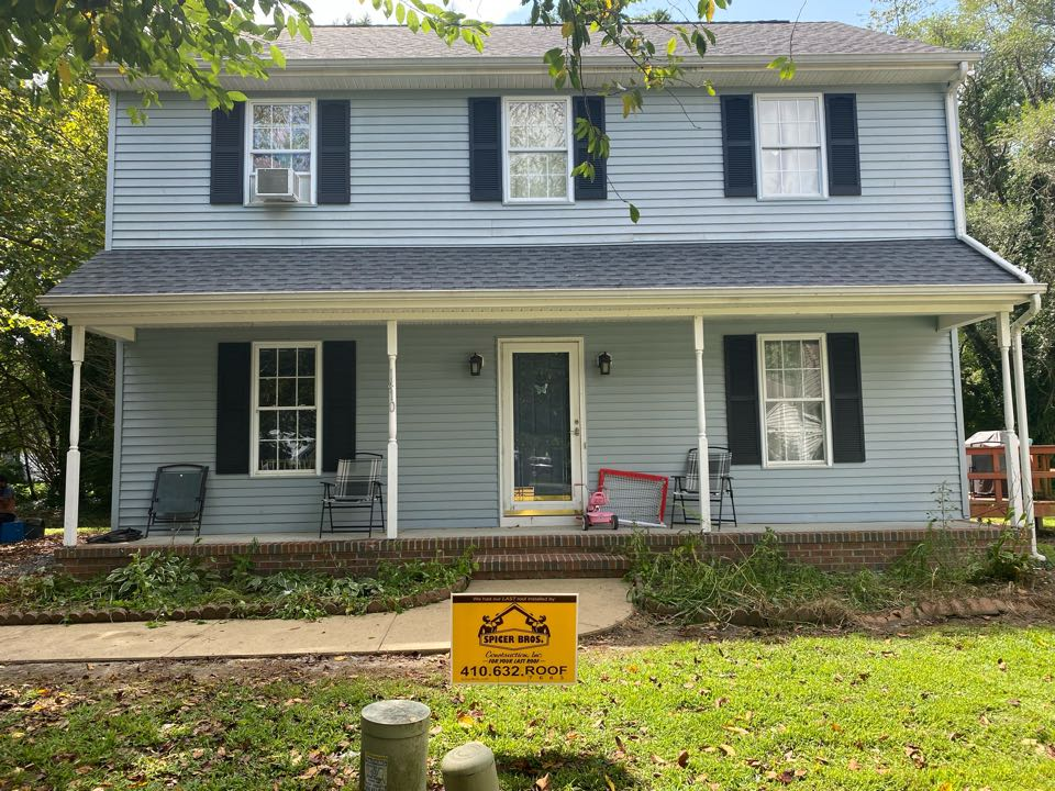 Salisbury, MD - We just finished replacing this house with brand new Timberline HDZ shingles pewter grey in color and installed a new ridge vent using GAF snow country.