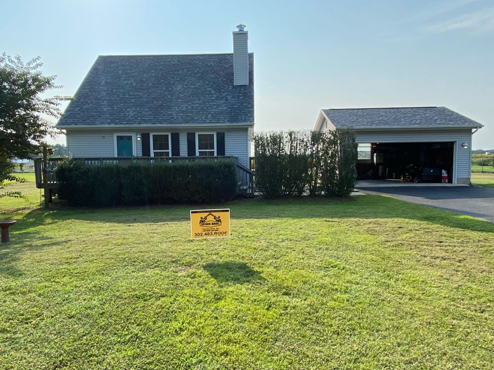 We just finished replacing this house with brand new Owens Corning shingles Pacific Blue in color and installed a brand new ridge vent.