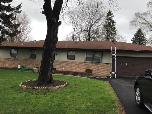 Minneapolis, MN - This homeowner requested a free roof inspection. We did the roof inspection and the rep from Country Financial Insurance found sufficient hail damage on the roof. We helped the homeowner file a claim with Country Financial. We met the insurance adjuster and he agreed there was enough damage. Country Financial paid for a full roof replacement. This homeowner chose Tamko Heritage shingles, Rustic Redwood in color. We replaced this roof May 2nd, 2017.