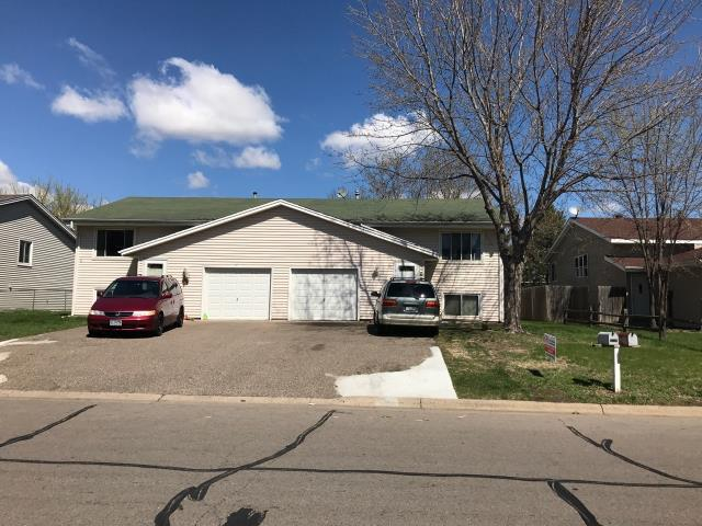 Minneapolis, MN - This homeowner requested a free roof inspection for his duplex. We did the roof inspection and the rep from Country Financial Insurance found sufficient hail damage on the roof. We helped the homeowner file a claim with Country Financial. We met the insurance adjuster and he agreed there was enough damage. Country Financial paid for a full roof replacement. This homeowner chose Tamko Heritage shingles, Rustic Redwood in color. We replaced this roof May 3rd, 2017.