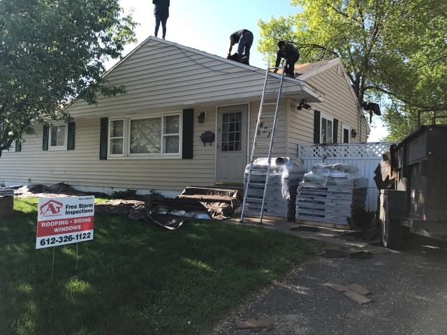 Minneapolis, MN - This homeowner requested a free roof inspection. We did the roof inspection and found sufficient hail damage on the roof. The State Farm Insurance rep also found damage. We helped the homeowner file a claim with State Farm. We met with the insurance adjuster and he agreed there was enough damage to make a claim. State Farm paid for a full roof replacement. This homeowner chose Tamko Heritage shingles in a Rustic Brown color. We replaced this roof on May 13th, 2017.