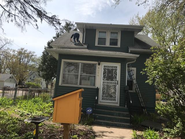Minneapolis, MN - This homeowner requested a free roof inspection. We did the roof inspection and found sufficient hail damage on the roof. The Travelers Insurance rep also found damage. We helped the homeowner file a claim with Travelers. We met with the insurance adjuster and he agreed there was enough damage. Travelers paid for a full roof replacement. This homeowner chose Tamko Heritage shingles, Thunderstorm Gray for the color. We replaced this roof on May 15th, 2017. Call for your free roof inspection today!!!- 612-326-1122