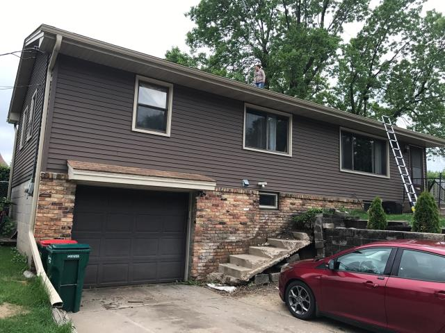 Minneapolis, MN - This homeowner requested a free roof inspection. We did the inspection and found sufficient hail damage. Then we helped the homeowner file a claim with American Strategic Insurance (ASI). We met with the adjuster and they agreed with our findings. ASI PAID FOR FULL ROOF & SIDING REPLACEMENT! This homeowner chose Tamko Heritage shingles, Thunderstorm Gray in color. We replaced this roof May 27th, 2017. YOU may have HAIL DAMAGE and not even know! CALL KAT for your FREE, NO OBLIGATION, ROOF INSPECTION!!! It only takes 15-20 minutes to inspect and we tell you if you have the damage or not. We work with ALL insurance companies! CALL KAT Construction for your FREE ROOF INSPECTION TODAY!! 612-326-1122