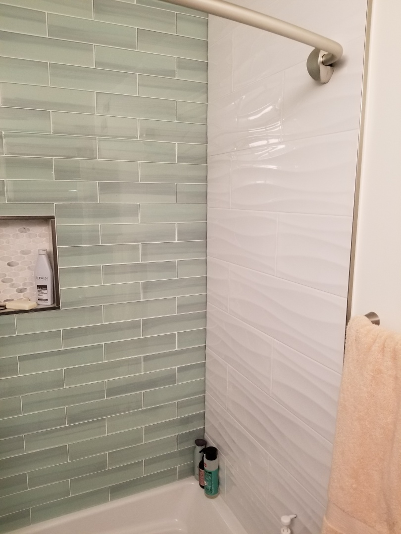 Arlington Heights, IL - Beautiful upgrade to a hall bath. Glass subway and custom sized niche.