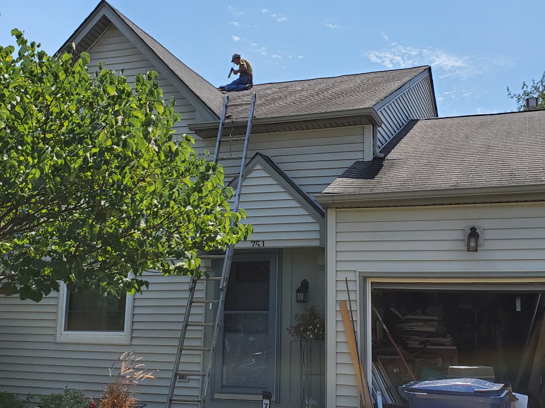Glendale Heights, IL - Installing a new bathroom vent in the roof in Glendale Heights.