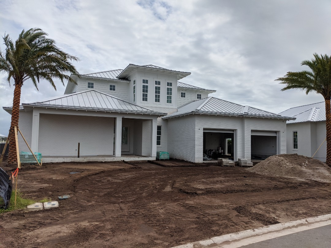 "Jacksonville, FL - New Standing Seam Roofing for Custom Homes.  Coastal living requires top quality materials, Aluminum 1.5"" standing seam roofing with kynar bright silver painted finish and stainless steel fasteners."