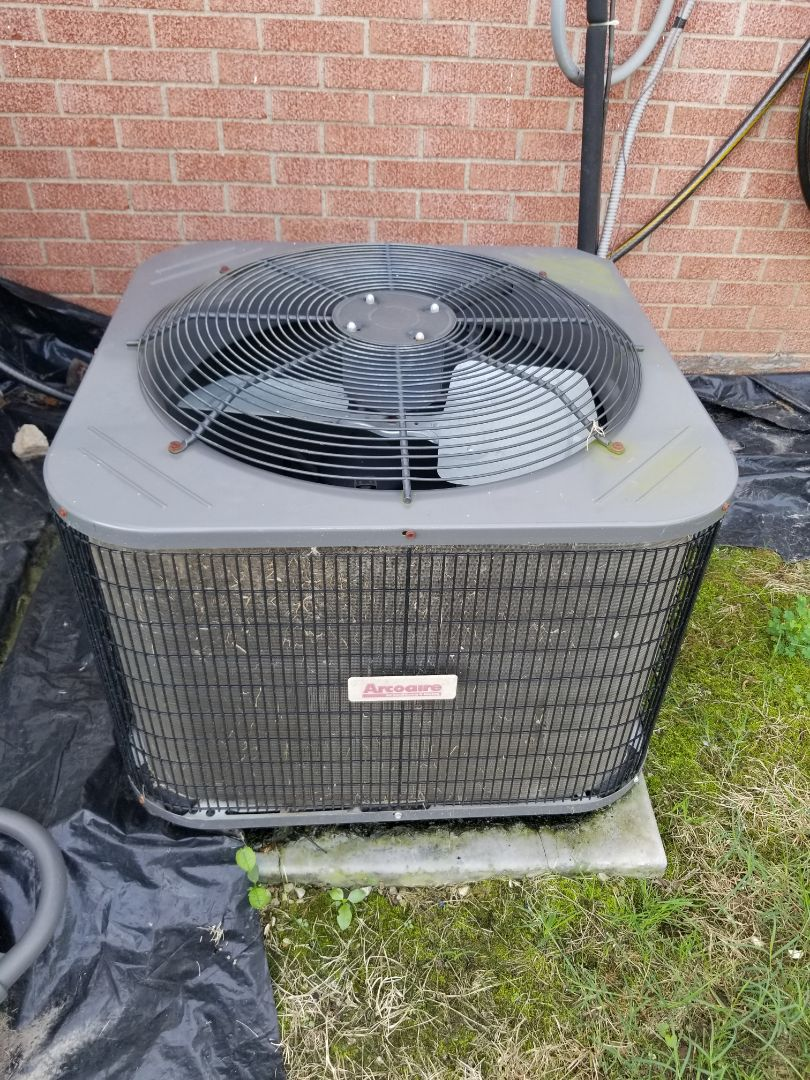 Granite City, IL - Performing service on an Arcoaire air conditioner.