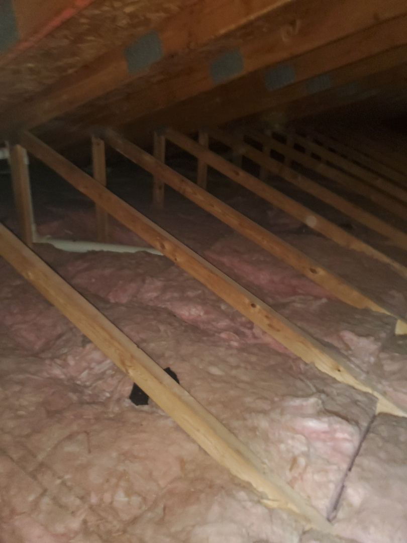 Inspecting attic insulation levels at a home in Highland, IL.