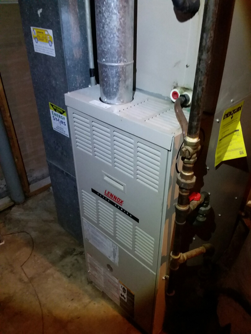 Performing a clean and check on an older Lennox furnace for a new customer in  Florissant, Mo.