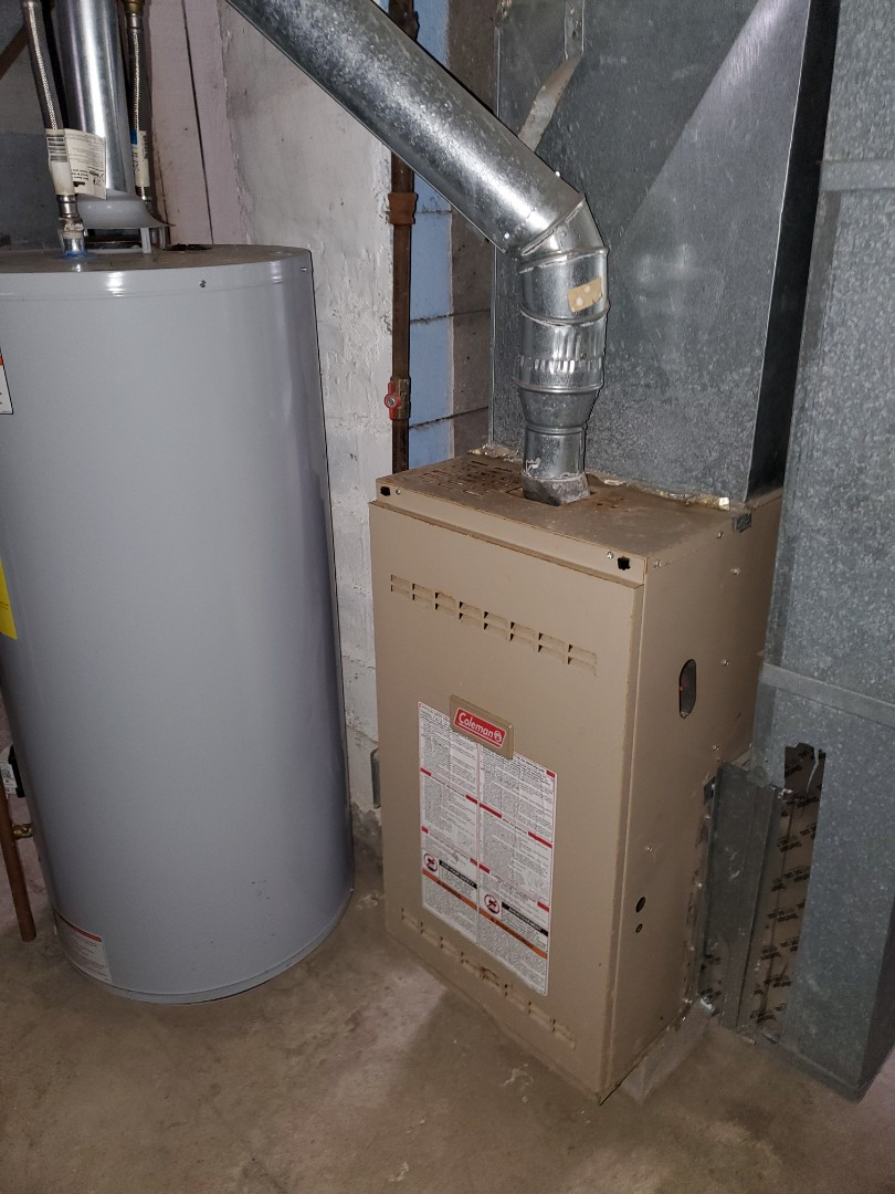Giving a free estimate for a new YORK high efficiency furnace.