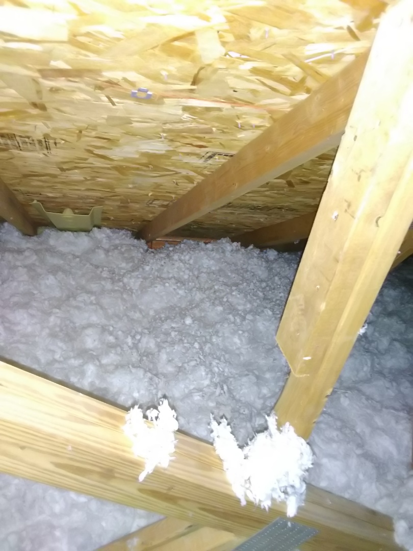 Discussing attic insulation levels, heating and cooling efficiency and options to upgrade at a home in Belleville!