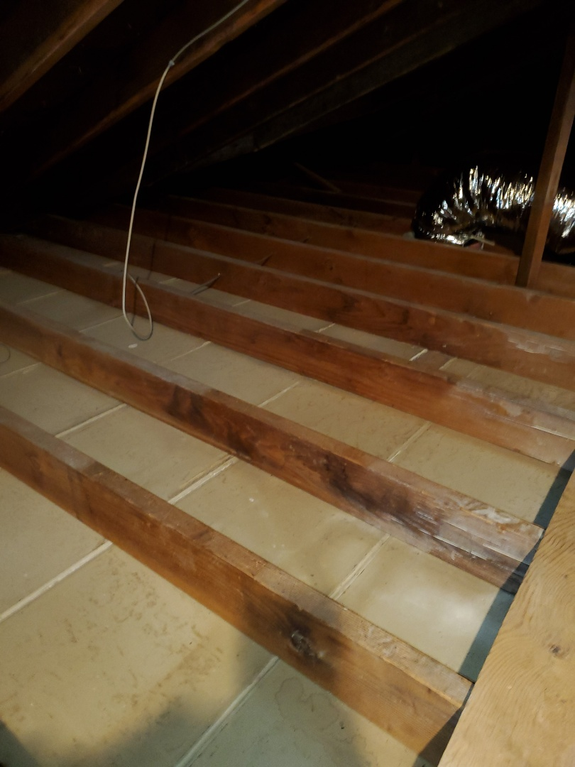 Inspecting a home after vermiculite remediation and providing an estimate for blown in cellulose attic insulation.